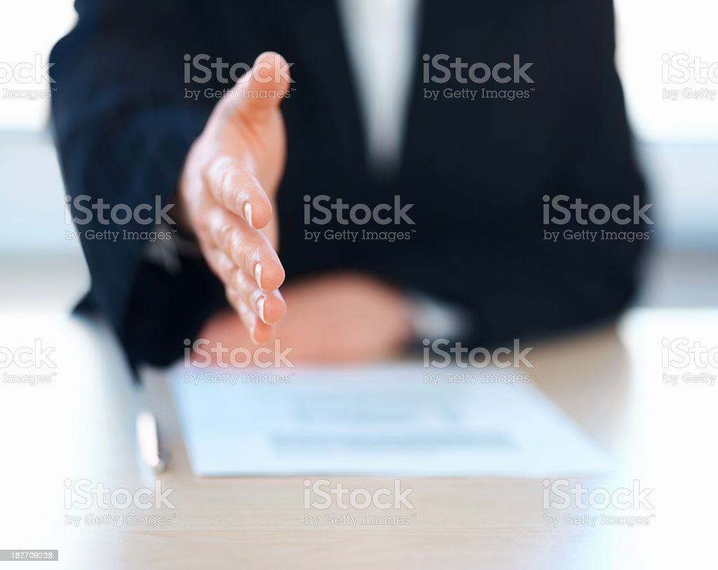 Mid section of a friendly business woman extended handshake royalty-free stock photo