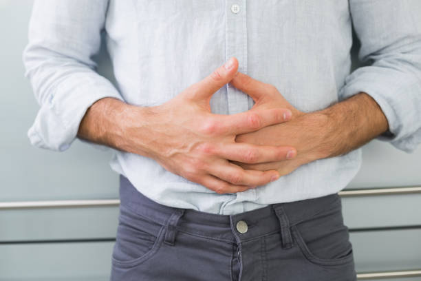 Mid section of a man suffering from stomach pain stock photo