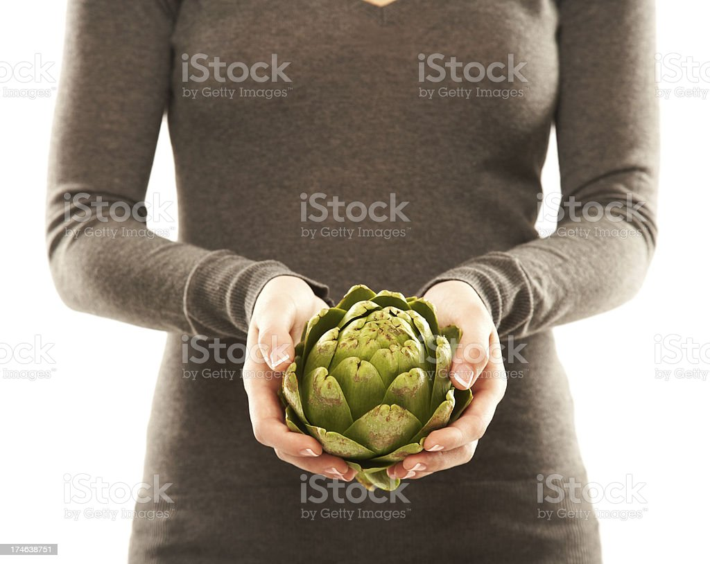 Mid section of a woman holding an Artichoke royalty-free stock photo