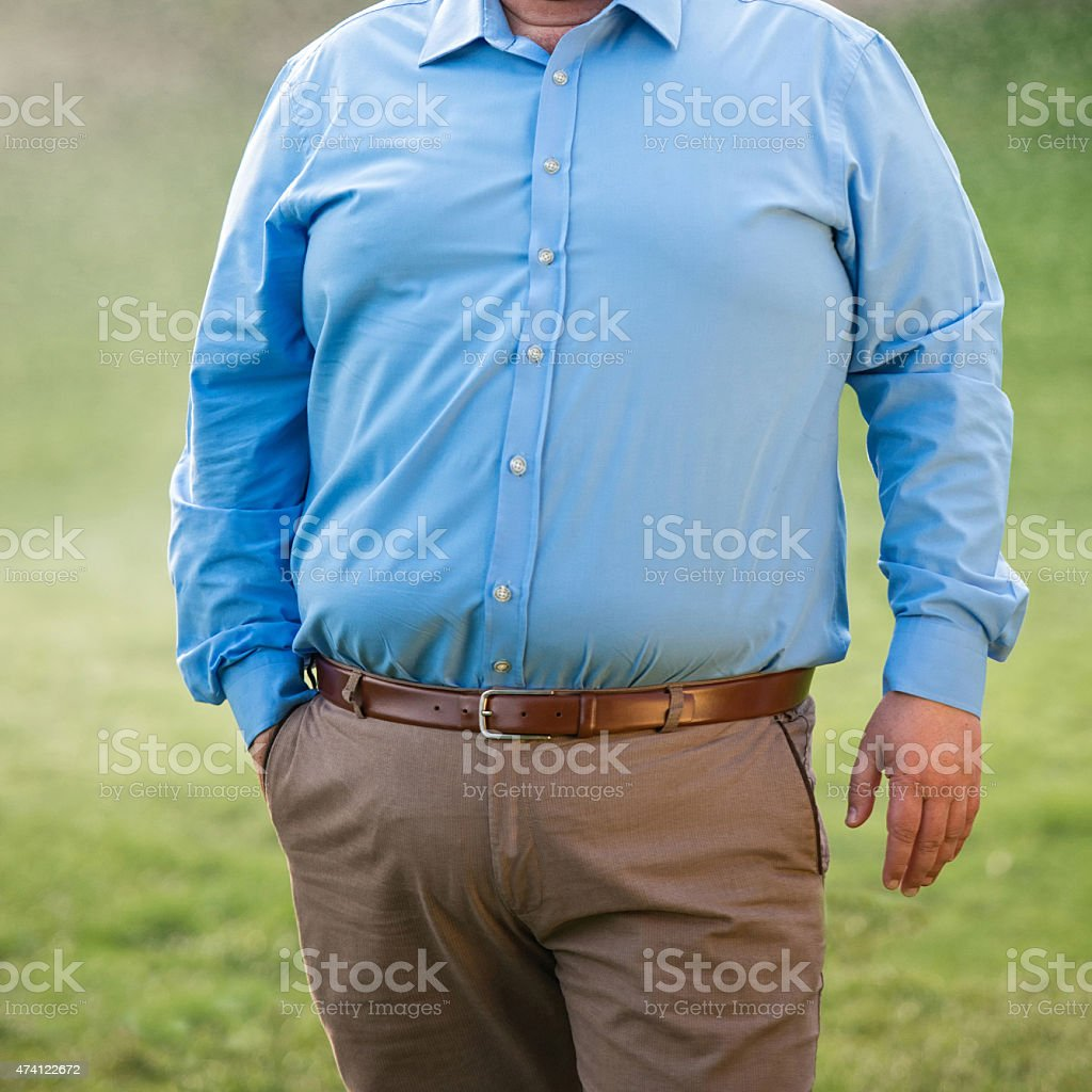 Front view of an overweight mature man, mid section, close-up. Square...