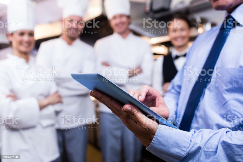 Mid section of manager using digital tablet stock photo