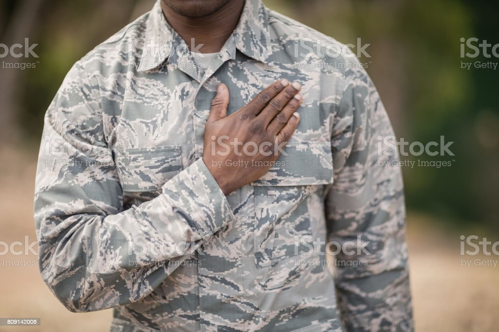 Mid section of soldier taking pledge stock photo