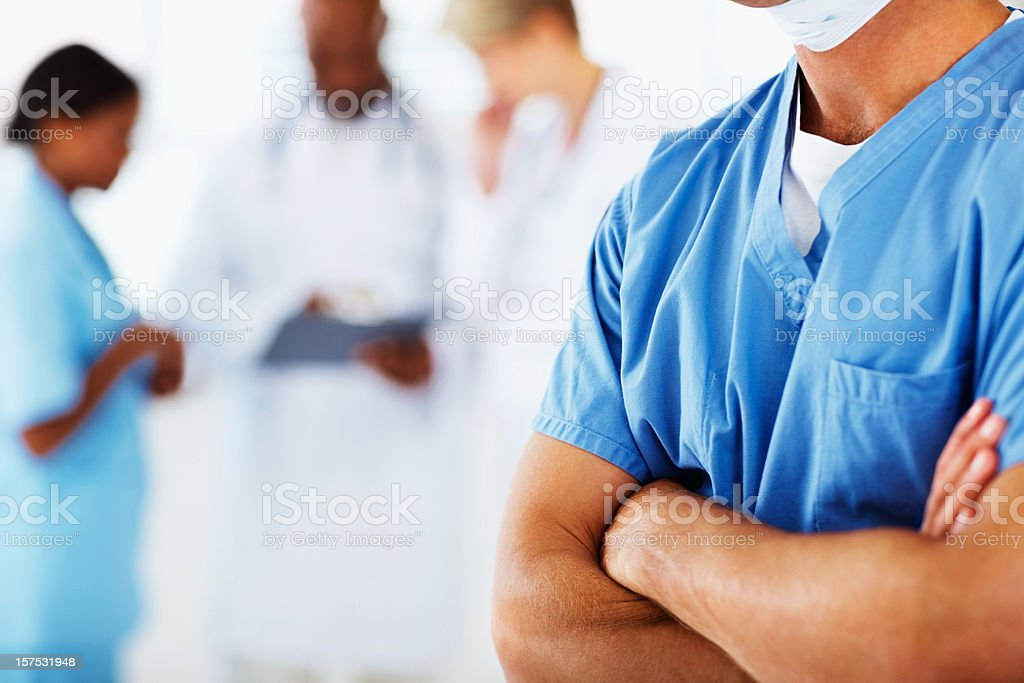 Mid section view of a doctor with hands folded royalty-free stock photo