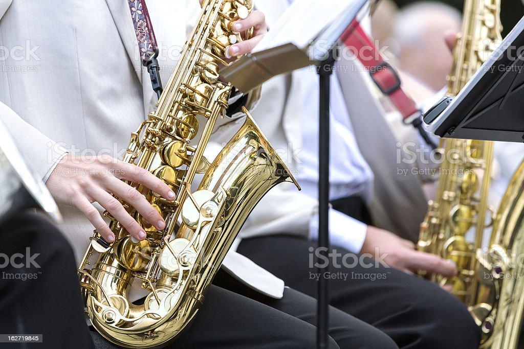 Mid section view of man playing saxophone royalty-free stock photo