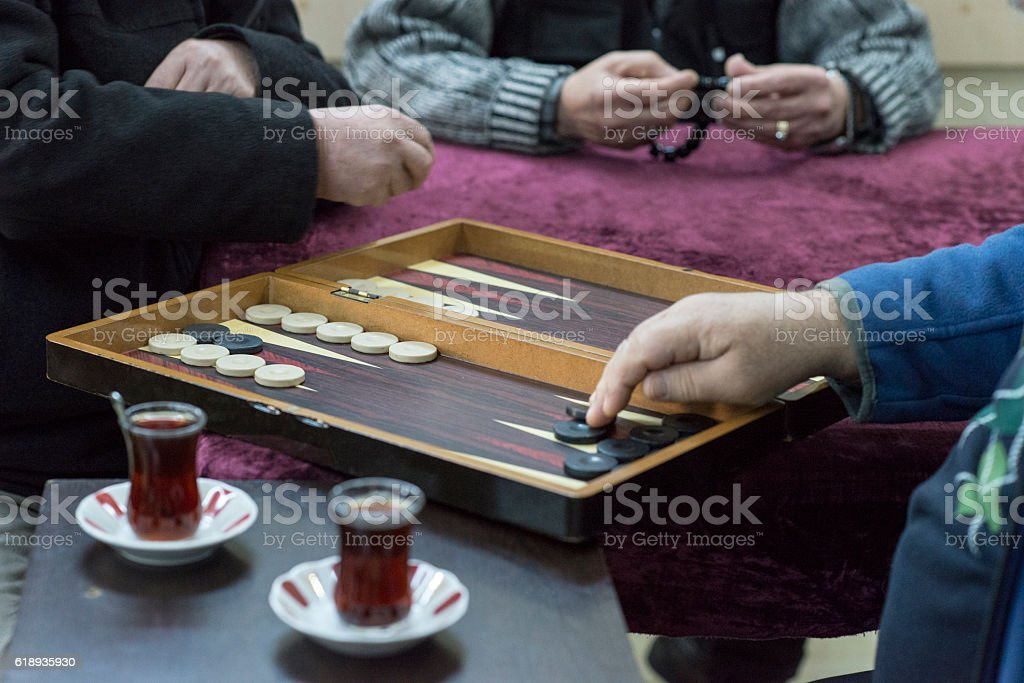 Mid section view of two man playing backgammon stock photo