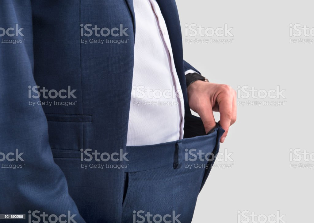 Mid section view of unrecognizable person losing weight against gray background stock photo
