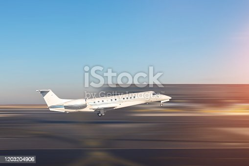 istock Mid size modern vip private jet departure and take-off on airport runway. Pilot asking air traffic control officer for take-off clearance. Luxury small corporate charter business aircraft trip 1203204906
