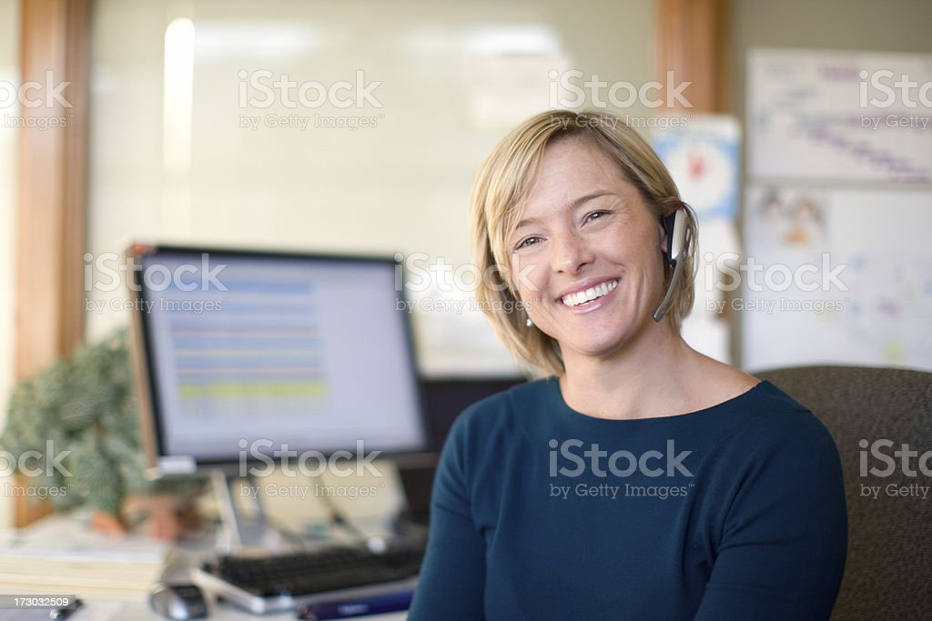 Mid thirties female with a headset on. stock photo