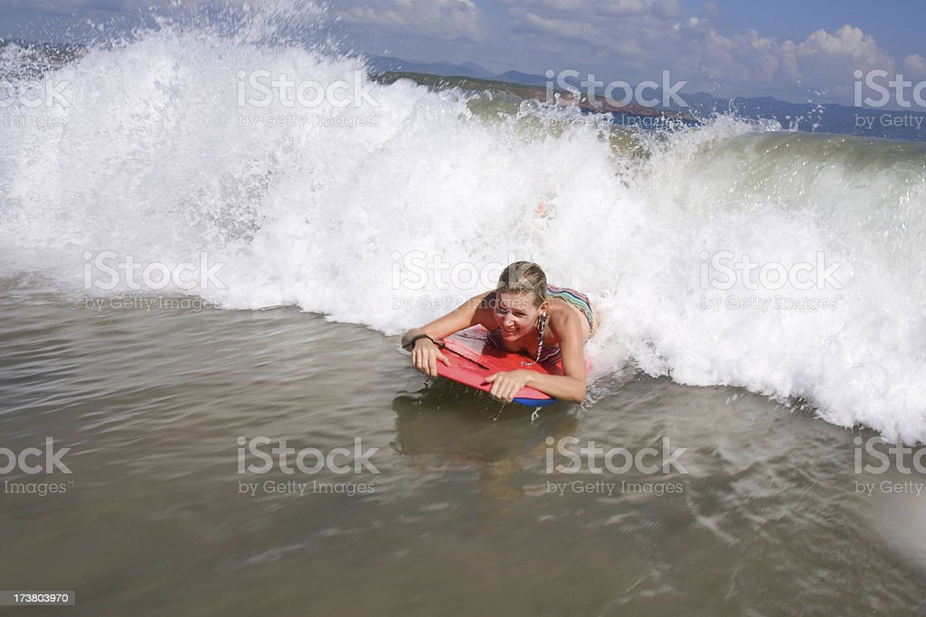 Mid thirties woman on a boogie board in Mexico royalty-free stock photo