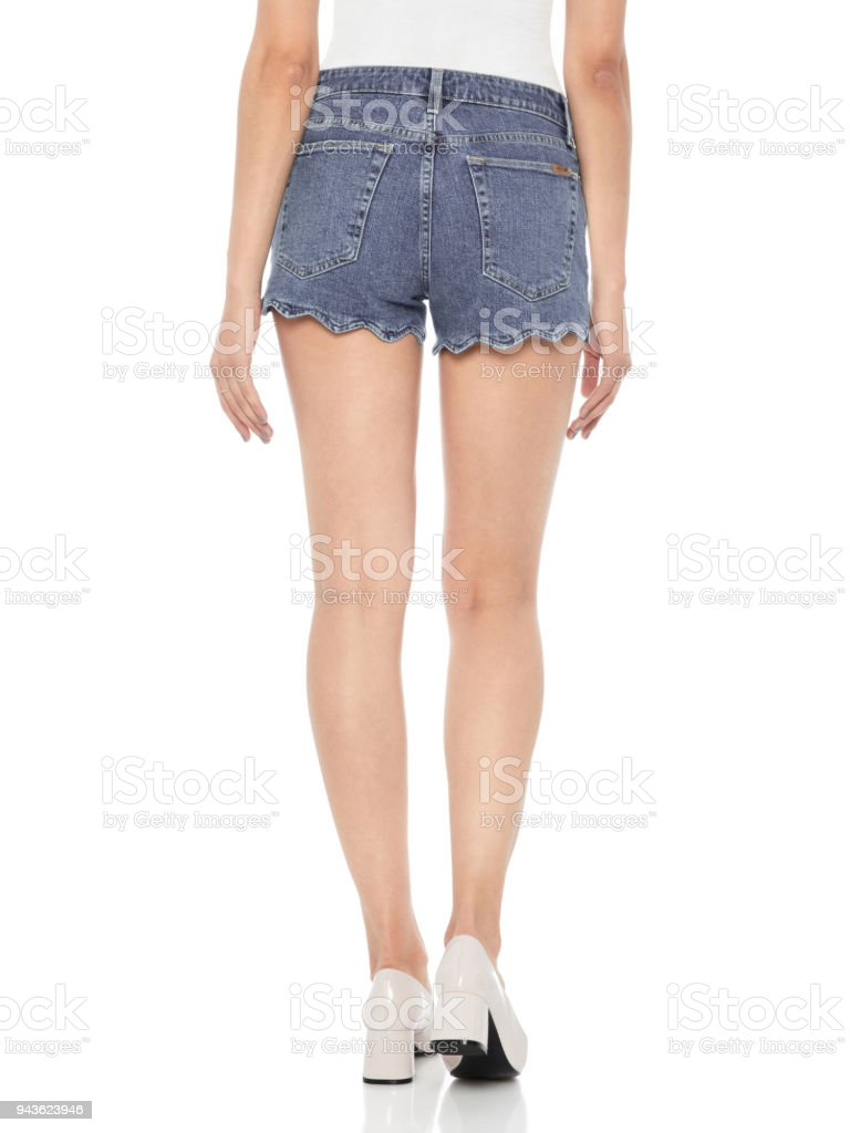 Mid Wash Ripped Denim High Waisted Shorts for Women, Bombshell High Waist Cutoff Denim Shorts, High Waist Acid Wash Ripped Distressed Shorts stock photo