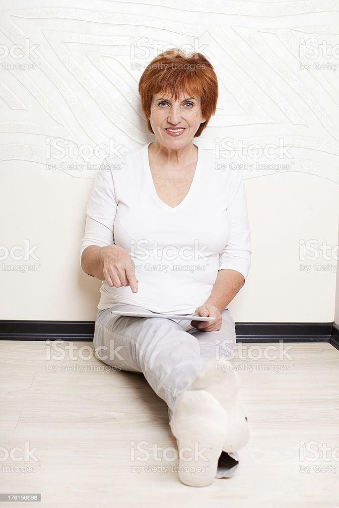 Mid woman with tablet pc royalty-free stock photo