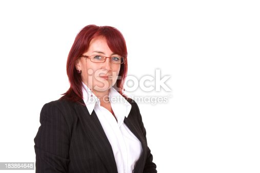 1132314350 istock photo Mid-adult businesswoman standing against white 183864648