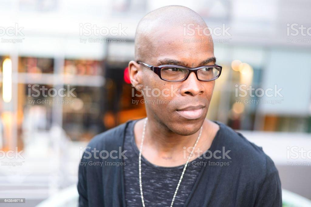 Mid-adult man looking away stock photo