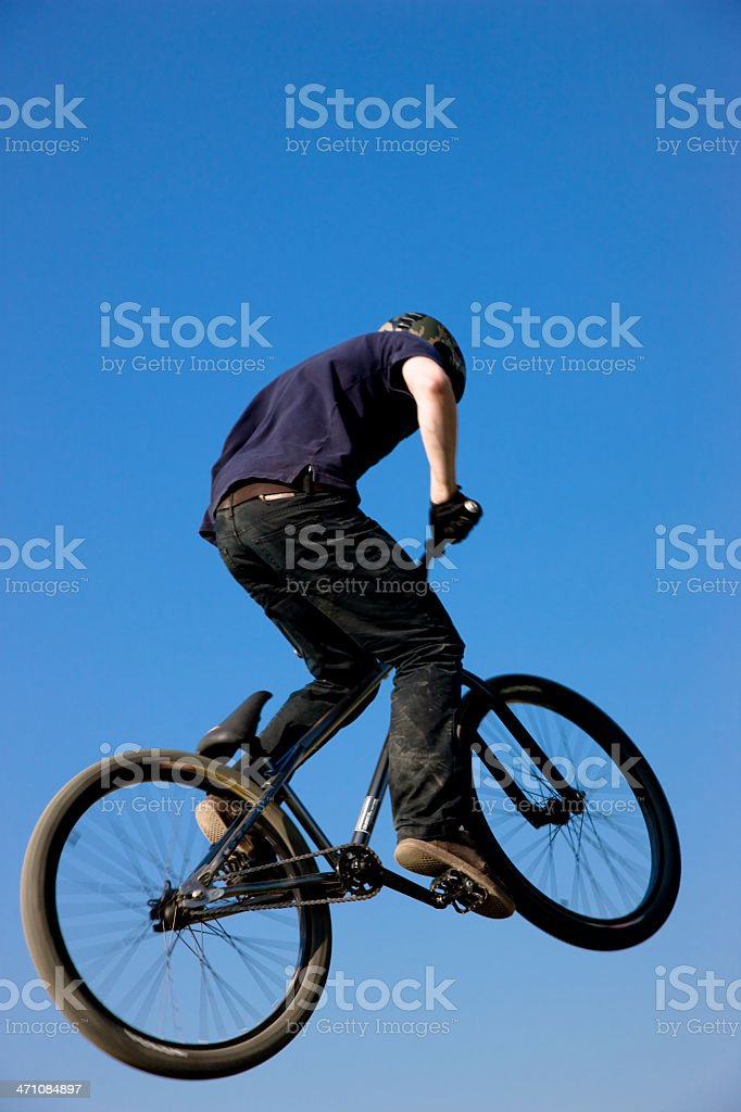 Mid-Air Dirt Jumping Biker Flying royalty-free stock photo