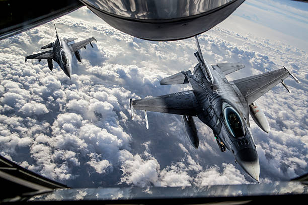 Mid-air Refueling Figher jets getting closer to KC-135 Stratotanker for mid-air refueling. air force stock pictures, royalty-free photos & images