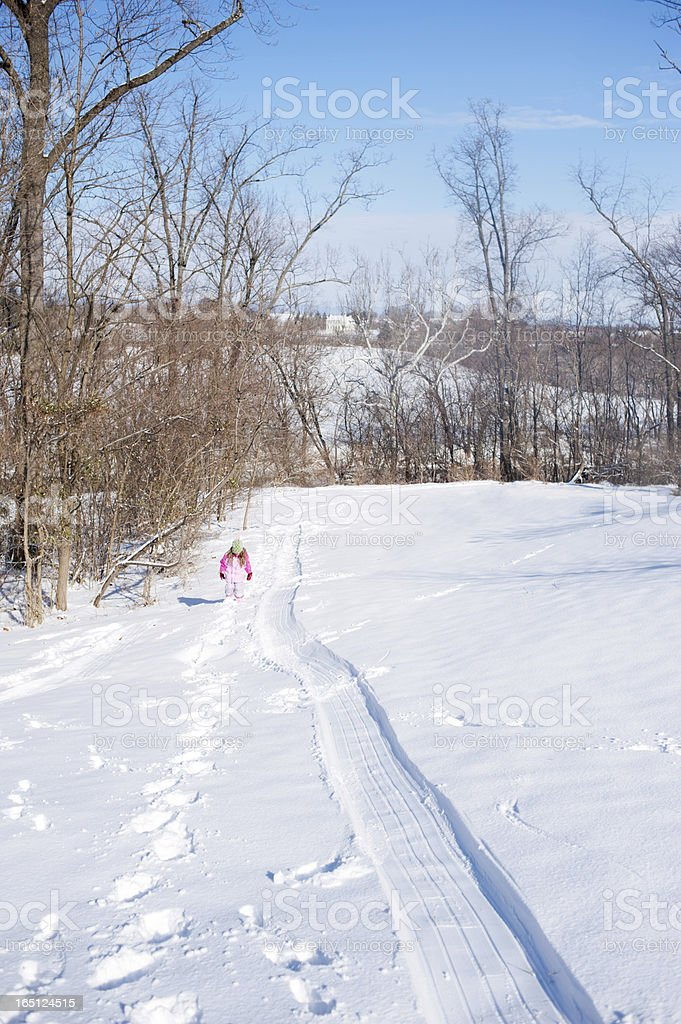 Mid-Atlantic Winter Scene with Young Girl on Sledding Hill stock photo