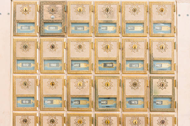 mid-century design brass post office mailboxes - midcentury design stock photos and pictures