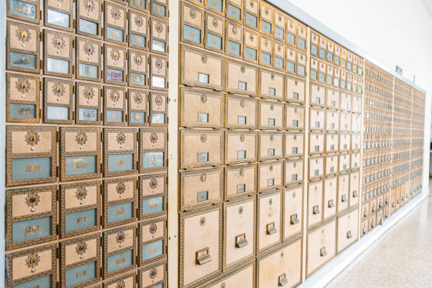 Mid-Century Design Brass Post Office Mailboxes stock photo