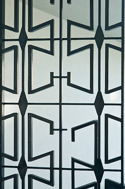 mid-century iron gate - midcentury design stock photos and pictures