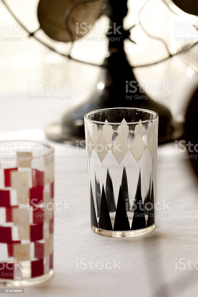 Mid-century juice glasses in checkerboard and backgammon patterns stock photo
