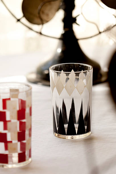 mid-century juice glasses in checkerboard and backgammon patterns - midcentury design stock photos and pictures