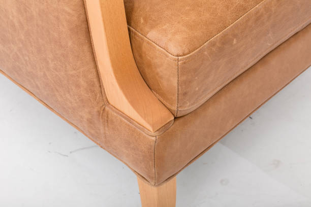 mid-century leather recliner, in top-grain leather, our rhys mid-century recliner, solid wood legs in a pecan finish. with white background - midcentury design stock photos and pictures