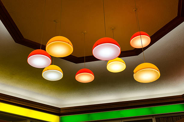 mid-century pendant lamps in mall - midcentury design stock photos and pictures
