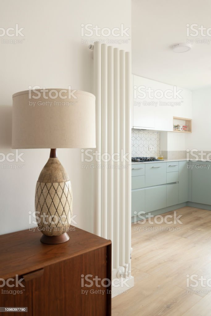 Mid-century table lamp by contemporary kitchen and design radiator stock photo