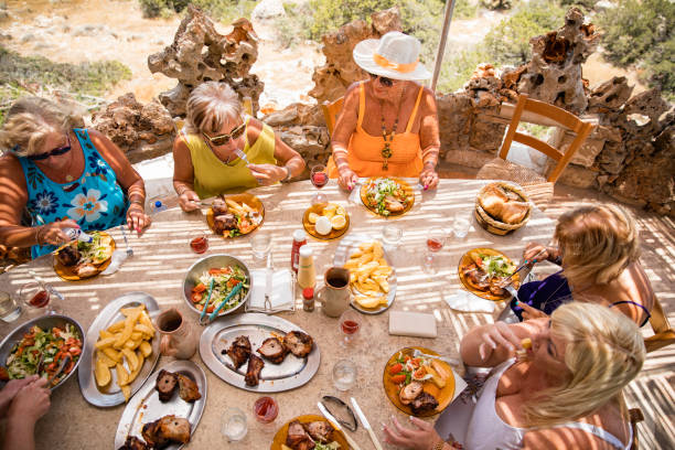 Midday Feast With Friends stock photo