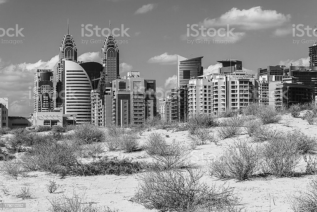 Midday heat in the desert on background buildings royalty-free stock photo