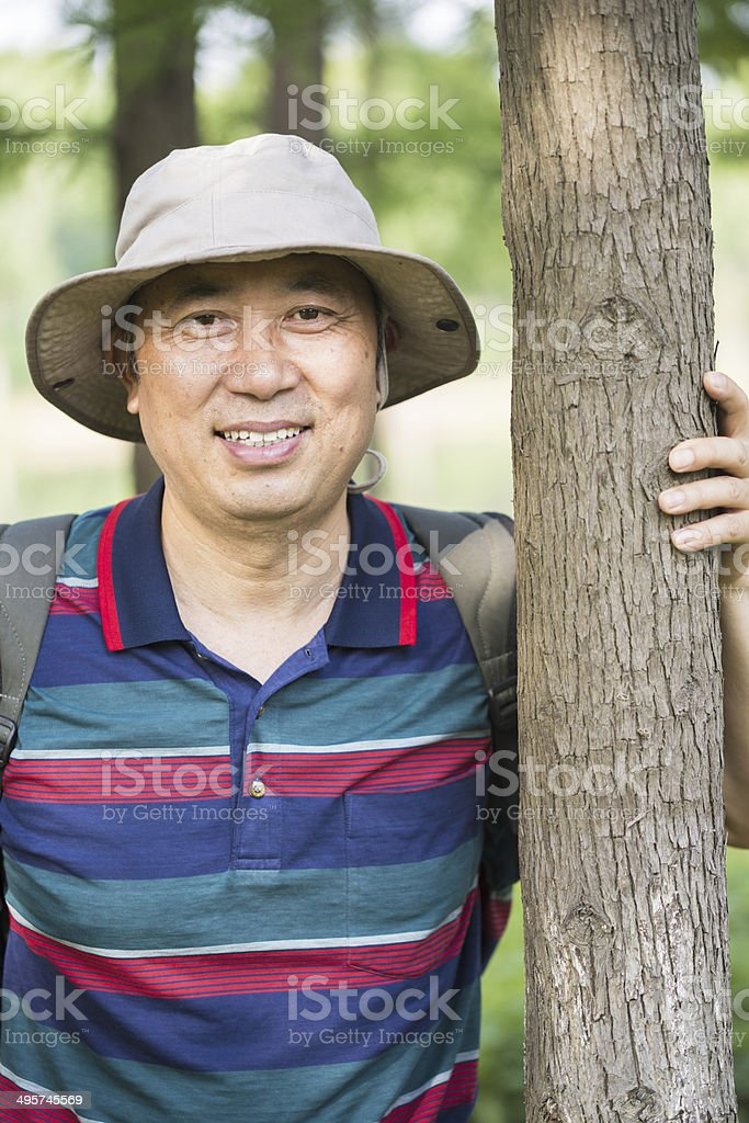Middle age asian man travelling stock photo