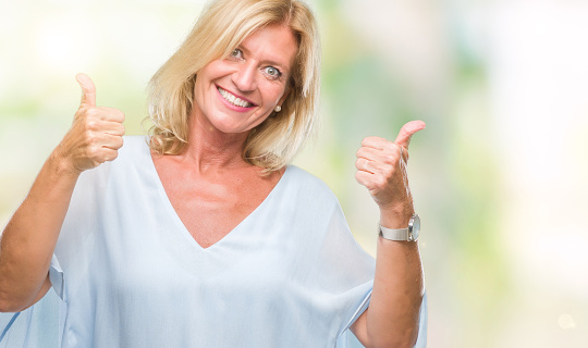 Middle Age Blonde Business Woman Over Isolated Background