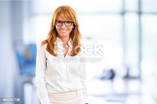 istock Middle age business woman portrait 469291738