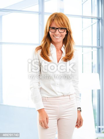 istock Middle age business woman portrait 469291740
