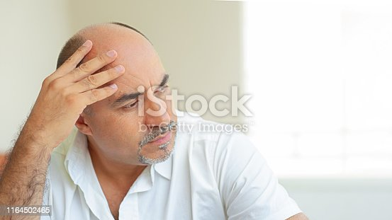 istock Middle age economic health and loneliness problems 1164502465