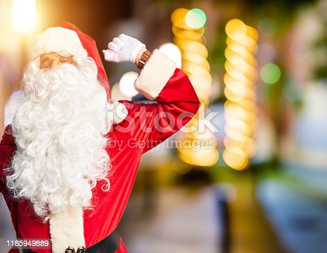 istock Middle age handsome man wearing Santa Claus costume and beard standing stretching back, tired and relaxed, sleepy and yawning for early morning 1185949889