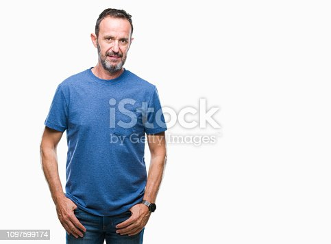 Middle age hoary senior man over isolated background with serious expression on face. Simple and natural looking at the camera.