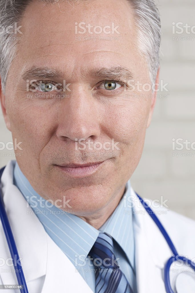 Middle age male doctor looking at camera royalty-free stock photo