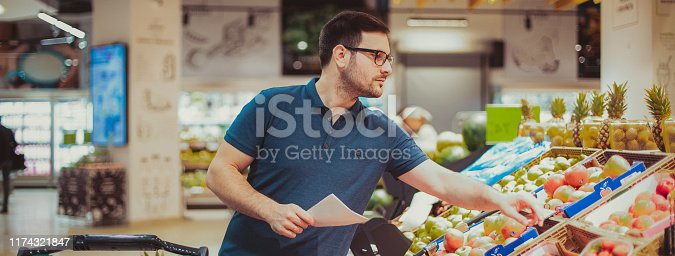 Middle age man buying vegetables at the market