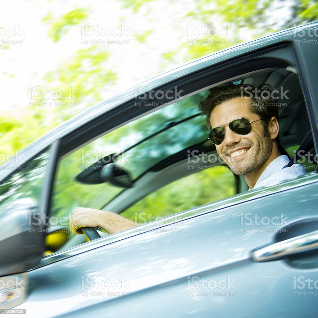 Middle age man driving a car stock photo
