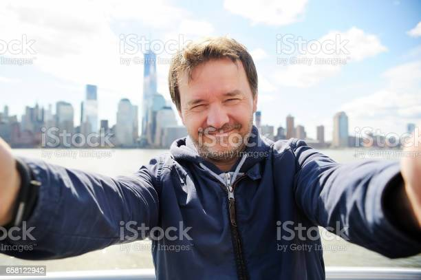 Middle age man making a self portrait with manhattan skyscrapers in picture id658122942?b=1&k=6&m=658122942&s=612x612&h=jntuchn3ipy8jgn mks821sxoayiduubseb663fc7xg=