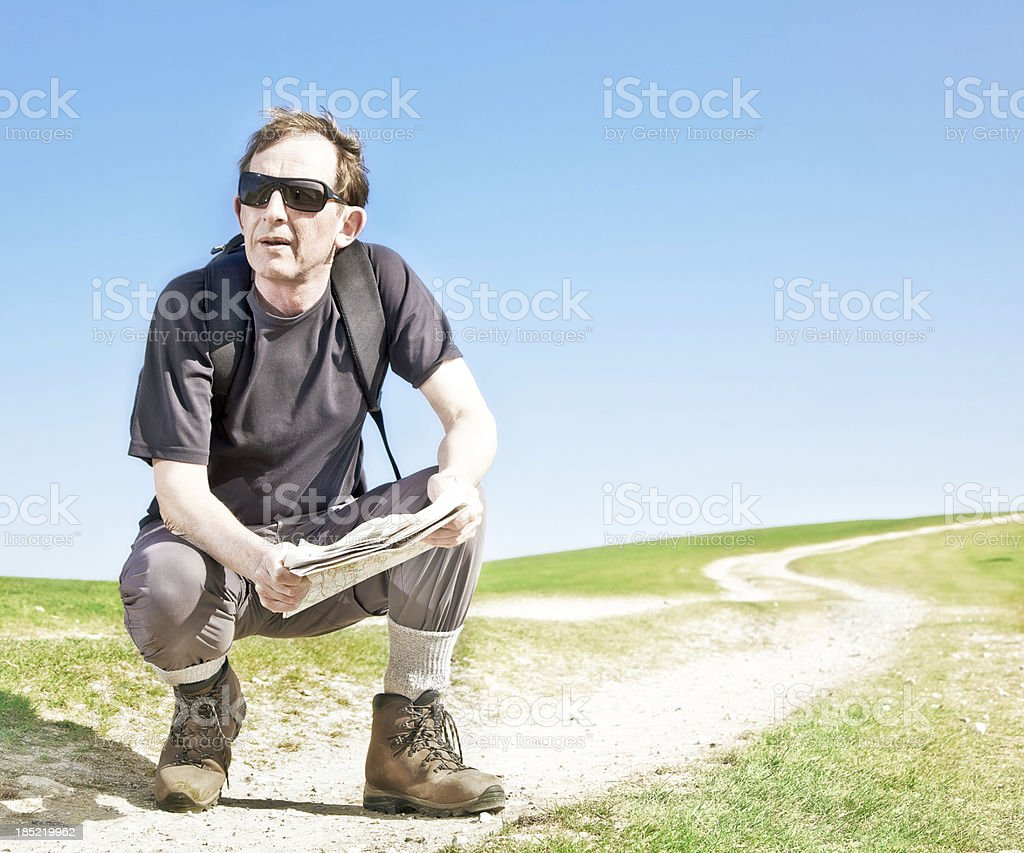 middle age man map reading stock photo