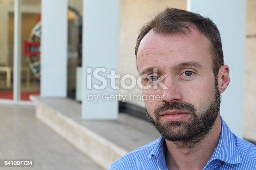istock Middle age man on urban background 641097724
