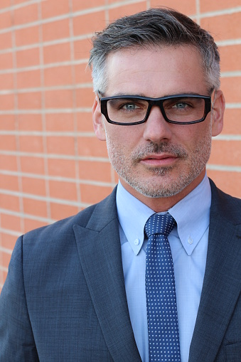 825083248 istock photo Middle Age Man Wearing Business Suit and Eyeglasses 648927840