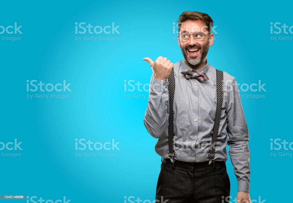 ed7dd8c7db80 Middle age man, with beard and bow tie pointing away side with finger -  Stock image .