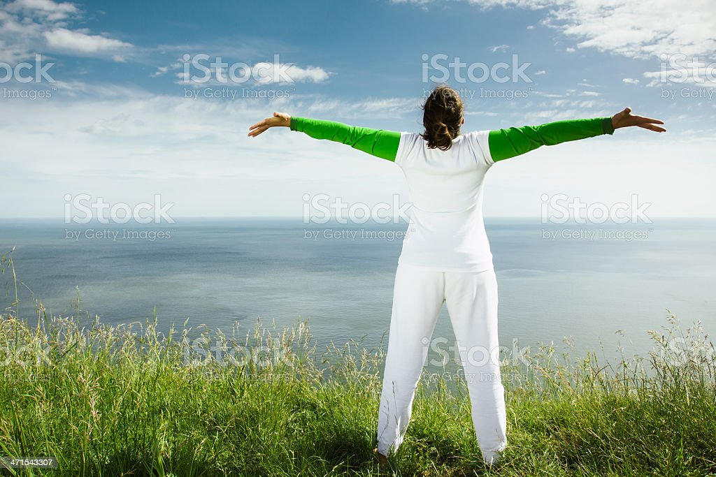 Middle age woman open arms outdoors royalty-free stock photo