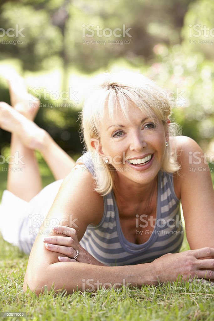 Middle age woman posing in park royalty-free stock photo