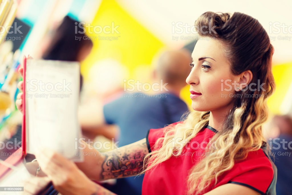 Middle age woman reading menu stock photo