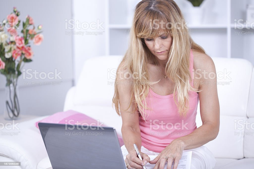 Middle age woman using web banking royalty-free stock photo