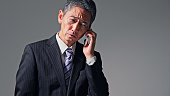 istock Middle aged asian businessman a using smart phone. 1280105511